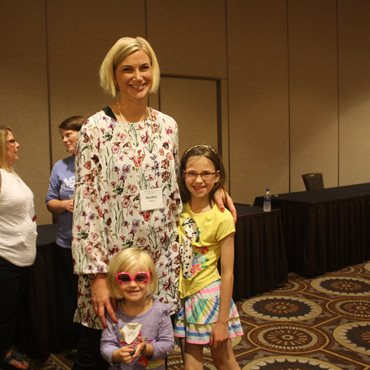 A mother and 2 daughters at the deaf-blind Family Learning Conference