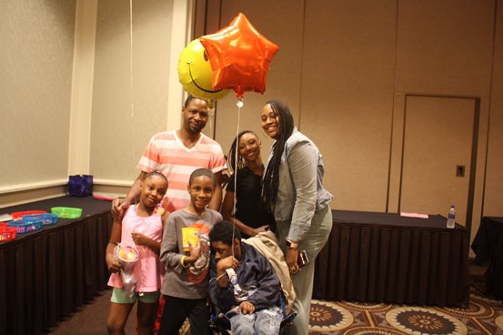 A family at the deaf-blind Family Learning Conference