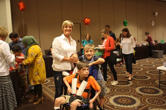 A mother and 2 sons at the deaf-blind Family Learning Conference